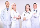 Medical workers on grey background — Stock Photo