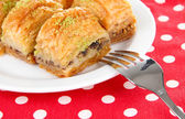 Sweet baklava on plate close-up — Stock Photo