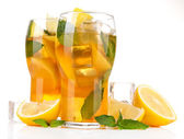 Iced tea with lemon and mint isolated on white — Stockfoto