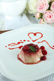Panna Cotta with raspberry sauce, on wooden background — Stock Photo