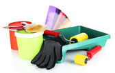 Plastic bucket with paint, roller, brushes and bright palette of colors isolated on white — Stock Photo
