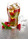 Iced tea with raspberries and mint isolated on white — Stock Photo