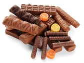 Delicious chocolate bars with marmalade sweets close up — Stock Photo