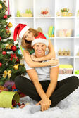 Happy young couple near Christmas tree at home — Стоковое фото