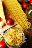 Pasta with oil, cheese and vegetables on wooden table close-up — Stock Photo