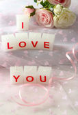 Candles with printed sign I LOVE YOU,on light background — Stock Photo