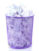 Recycle bin filled with crumpled papers, isolated on white — Stock Photo