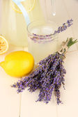 Lavender lemonade, on white wooden background — Stock Photo