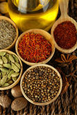 Many different spices and fragrant herbs on braided table close-up — Стоковое фото