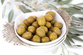 Olives in bowl with branch close up — Stock Photo