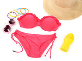Swimsuit and beach items isolated on white — Stock Photo
