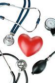 Tonometer, stethoscope and heart isolated on white — Stock Photo