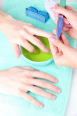 Man doing manicure in salon — Stock Photo