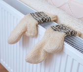 Socks drying on heating radiator — Stock Photo