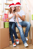 Couple celebrating New Years in new home — Stock Photo