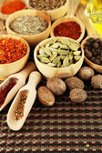 Many different spices and fragrant herbs on wooden table close-up — Stock Photo