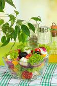 Greek salad on plate on table on light background — Stock Photo