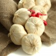 Vintage garlic and pepper decoration, on sackcloth, isolated on white — Stock Photo