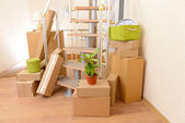 Stack of cartons near stairs: moving house concept — ストック写真