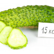 Stock Photo: Calorie content of cucumber isolated on white