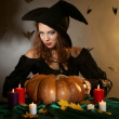 Stock Photo: Halloween witch on dark background