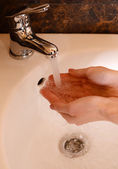 Human hands being washed — Stock Photo