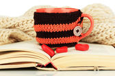 Cup with knitted thing — Stock Photo