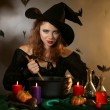 Halloween witch on dark background — Stock Photo #34278855