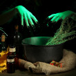 Witch in scary Halloween laboratory on dark color background — Stock Photo