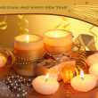 Beautiful candles, gifts and decor on wooden table on yellow background — Stock Photo #34395063