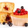 Tasty muffins with berries isolated on white — Stock Photo #34416037