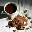 Cocoa powder in cup on wooden table — Stock Photo #34418781