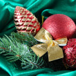 Foto de Stock  : Beautiful Christmas decor on green satin cloth