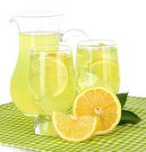 Delicious lemonade on table on white background — Stock Photo