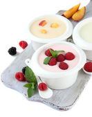 Delicious yogurt with fruit and berries isolated on white — Photo
