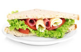 Tasty sandwich with salami sausage and vegetables on white plate, isolated on white — Стоковое фото