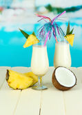 Pina colada drink in cocktail glasses, on bright background — Stock Photo
