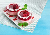 Delicious berry cakes on plate on table close-up — Stock Photo