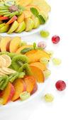 Sortiment krájeného ovoce na desky, izolované na bílém — Stock fotografie