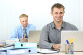 Man in office at workplace — Stock Photo