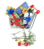 Christmas gifts in shopping trolley, isolated on white — Stok fotoğraf