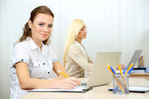 Woman in office at workplace — Stock Photo