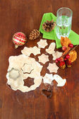 Making Christmas cookies on wooden table — Stock Photo