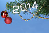 2014 hang on Christmas tree close-up on blue background — Stock Photo