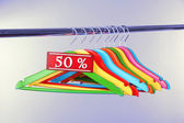 Wooden clothes hangers as sale — Stock Photo