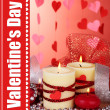 Stock Photo: Candles for Valentine's Day on wooden table on red background