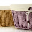 Two empty color wicker baskets, isolated on white — Stock Photo