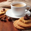 Stock Photo: Cup of tasty coffee with tasty cookies, on wooden background
