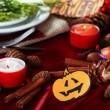 Table setting for Halloween with pumpkin and candles close-up — Stock Photo #34428625