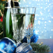 Composition with Christmas decorations and two champagne glasses, on bright background — Stock Photo #34429021